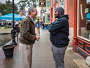 19 OCTOBER 2019 - DES MOINES, IOWA: MARK SANFORD (R-SC), left, talks to a coffee shop manager in Des Moines  during a campaign visit to the Des Moines Farmers' Market Saturday. Sanford, a former Republican governor and Congressman from South Carolina, is challenging incumbent President Donald Trump for the Republican nomination for the US presidency. Iowa hosts the first event of the presidential selection cycle. The Iowa Caucuses are scheduled for February 3, 2020.              PHOTO BY JACK KURTZ