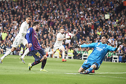 March 2, 2019 - Madrid, Madrid, Spain - Lionel Messi (forward; Barcelona), Thibaut Courtois (goalkeeper; Real Madrid), Raphael Varane (defender; Real Madrid) in action during La Liga match between Real Madrid and FC Barcelona at Santiago Bernabeu Stadium on March 3, 2019 in Madrid, Spain (Credit Image: © Jack Abuin/ZUMA Wire)