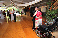 Photographer: Kevin Bartram.Radcliffe-Emmons 06-28-2008.Groom Patrick Emmons dances with his terminally ill sister Christa at his wedding reception in Vacaville, California.