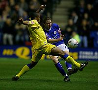 Photo: Steve Bond.<br />Leicester City v Leeds United. Coca Cola Championship. 13/03/2007.   Nils-Eric Johanson (right) clears