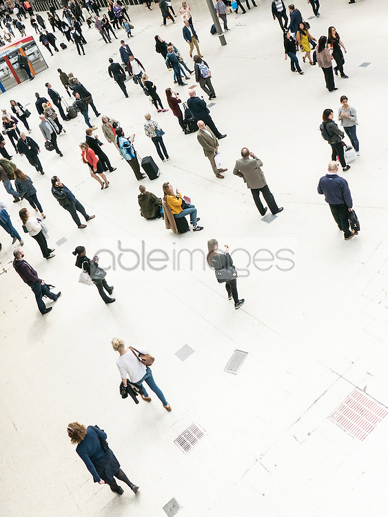 People Waiting at Train Station