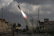Federal Police Rapid Response Forces fire an IRAM rocket towards Islamic State positions near the Old City, in Mosul, Iraq, Monday, March 20, 2017. (AP Photo/Felipe Dana)