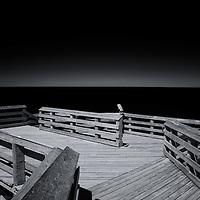 """On the Horizon""<br /> <br /> Beautiful black and white photograph on Lake Michigan at overlook #9, at Sleeping Bear Dunes National Lake Shore."
