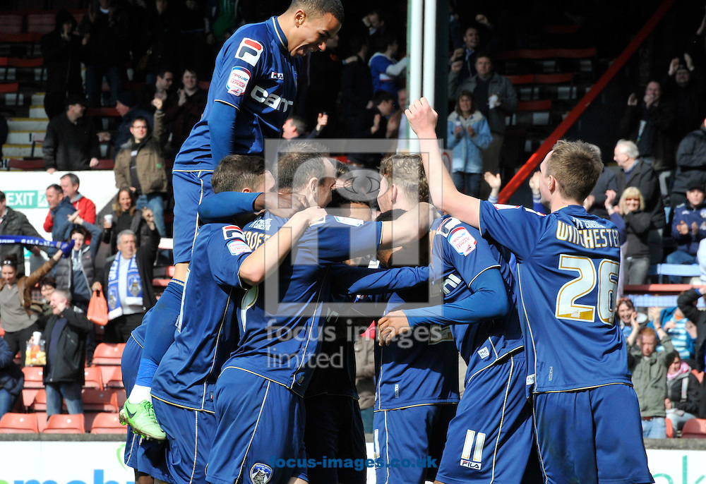 Picture by Alan Stanford/Focus Images Ltd +44 7915 056117.27/04/2013. Oldham Athletic players celebrate scoring during the npower League 1 match at the Matchroom Stadium, London.. .
