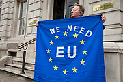 Anti Brexit campaigner with an EU flag protests outside the Cabinet Office in Whitehall as Ministers hold a Brexit Cabinet meeting on 16th August 2019 in London, United Kingdom.