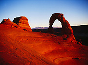 Delicated Arch framing the LaSal Mountain in late afternoon light, Arches National Park, Utah.