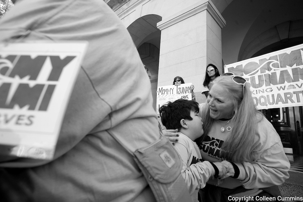 Alex leans into kiss his grandmother Mary as they arrive on the north steps of the California state capitol in Sacramento Months of planning and connecting with other parents of disabled children finally came to a crescendo when after four days of walking on and off Mary and Alex arrived to deliver the Lanterman Act to Governor Jerry Brown.