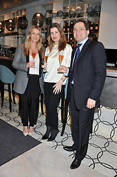 Left to right, ANYA HINDMARCH winner of the 2012 Veuve Clicquot Business Woman Award, ELSA CORBINEAU and CYRIL BRUN attending the Veuve Clicquot Business Woman Previous Winners Dinner held at Grace, 11c West Halkin Street, London on 16th April 2013.