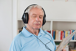 Senior man listening to music with closed eyes