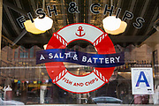 A Salt & Battery shop window sign on 112 Greenwich Avenue, New York City,  New York, United States of America.  The cafe restaurant serves traditional British Fish and Chips.
