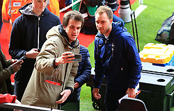 Tottenham Hotspur's Christian Eriksen takes a photo with fans before the game