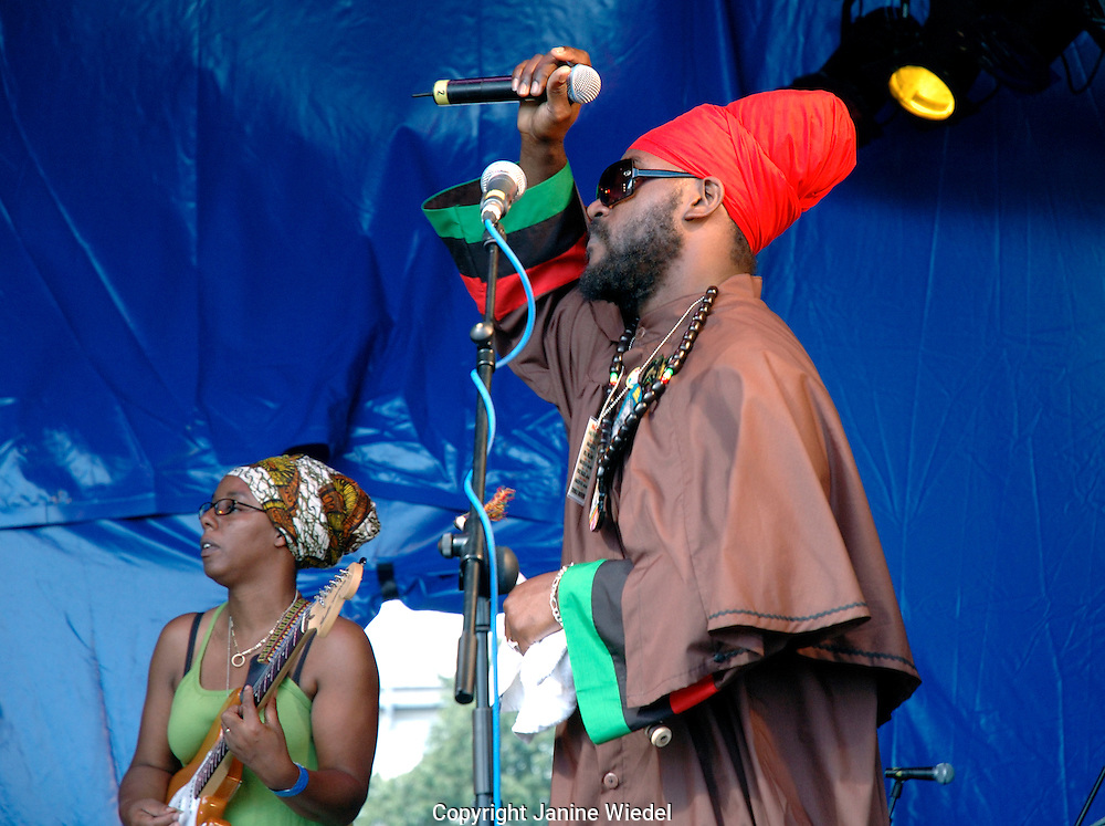 Rastafarian musicians playing concert in Brockwell Park South London.