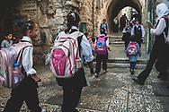 Palestinian children walk to school in the Muslim Quarter of Jerusalem's Old City on October 20, 2010.