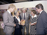 10/09/1988<br /> 09/10/1988<br /> 10 September 1988<br /> ROSC 1988 Exhibition at the Guinness Hop Store. <br /> Sir Norman Macfarlane, (centre) Chairman of Guinness plc. chatting with  Mr Pat Barry, (left) Director of Corporate Affairs, Guinness Ireland and Lady Gretta Macfarlane (2nd from left) during Sir Norman's visit to ROSC '88.