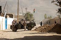 """26 SEP 2004, FEYZABAD/AFGHANISTAN:<br /> Bundeswehrsoldaten des Provincial Reconstruction Teams des Deutschen Einsatzkontingents ISAF, PRT ISAF, mit einem Mercedes Geländewagen """"Wolf"""" sichern die Strasse zum Nebeneingang des Lagers Feyzabad<br /> IMAGE: 20040926-01-063<br /> KEYWORDS: Faisabad, Reise, Soldat, Soldaten, Auslandseinsatz, Jeep"""