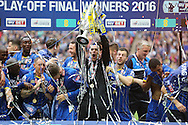 Goalkeeper Kelle Roos of AFC Wimbledon celebrates as he lifts the Sky Bet League 2 Play-off Trophy. Skybet football league two play off final match, AFC Wimbledon v Plymouth Argyle at Wembley Stadium in London on Monday 30th May 2016.<br /> pic by John Patrick Fletcher, Andrew Orchard sports photography.