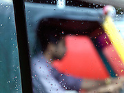 View through a car window of a rickshaw driver, Cochin, Kerala, India