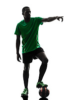 one african man soccer player green jersey free kick in silhouette on white background