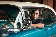 Micco poses in this car that is not third generation in his family. Micco's senior portraits created by Arkansas commercial photographer, Alex Kent