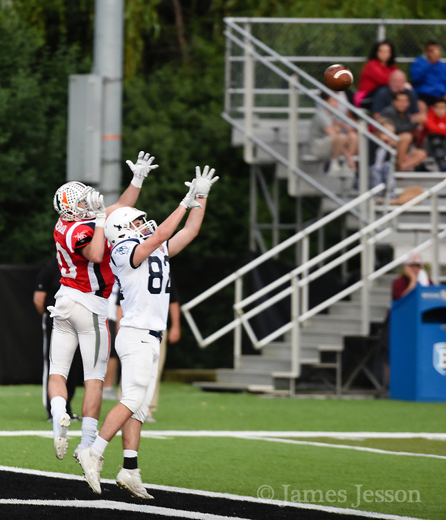 North Squad's Ben Quint, from Lexington High School, tries to intercept a pass during the Shriner's All-Star Football Classic at Bentley University in Waltham, June 22, 2018.   [Wicked Local Photo/James Jesson]