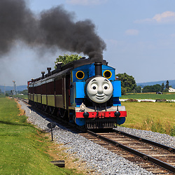 Strasburg, PA – June 19, 2016: Thomas the Tank Engine chugs toward the train station in Strasburg, Lancaster County.