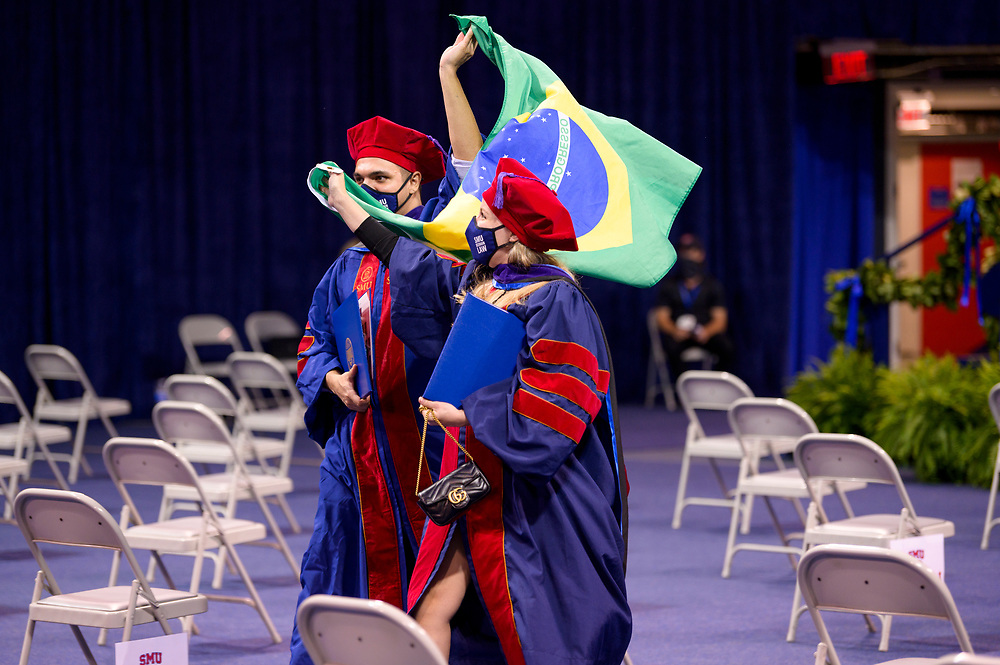Students from the Law Class of 2020, attend their delayed graduation from Dedman School of Law due to the Covid-19 Pandemic, Saturday, May 15, 2021 in Moody Coliseum on the SMU Campus.