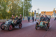 Heading down the Mall as the sun rises - The London to Brighton Veteran Car Run, which dates back to 1927, was founded to commemorate the Emancipation Run of 1896, which celebrated the new-found freedom of motorists granted by the 'repeal of the Red Flag Act.' The Act raised the speed limit to 14mph and abolished the need for a man carrying a red flag to walk ahead of the cars whenever they were being driven. It is the longest running motoring event in the world, this year has a French theme in honour of the country's contribution to motoring's early days. It is is organised by the Royal Automobile Club.