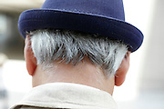 man with graying hair wearing a hat