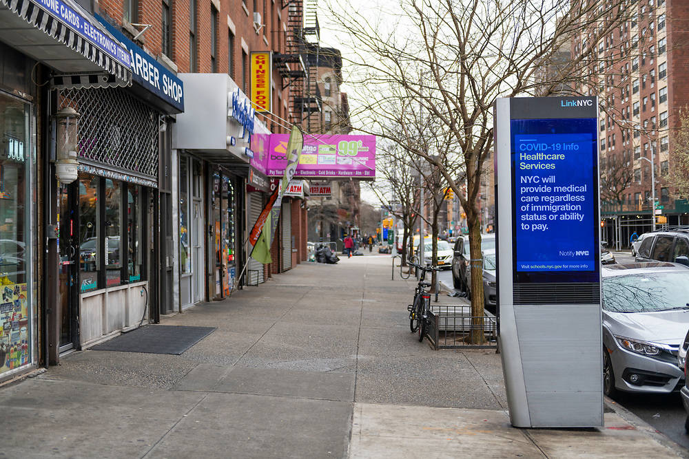 New York City, USA - March 19, 2020: A public annoucement on a digital display in Harlem says that New York City will provide medical care regardless of immigration status or ability to pay. The message is part of the city's response to the global coronavirus pandemic.