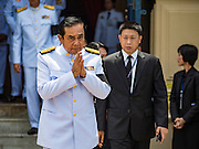 14 OCTOBER 2016 - BANGKOK, THAILAND: GENERAL PRAYUTH CHAN-O-CHA, The Prime Minister of Thailand, leaves the Sahathai Samakom Pavilion at the Grand Palace after paying respects to Bhumibol Adulyadej, the King of Thailand, who died Oct. 13, 2016. He was 88. His death comes after a period of failing health. Prayuth organized the coup that deposed Yingluck Shinawatra. With the king's death, the world's longest-reigning monarch is Queen Elizabeth II, who ascended to the British throne in 1952. Bhumibol Adulyadej, was born in Cambridge, MA, on 5 December 1927. He was the ninth monarch of Thailand from the Chakri Dynasty and is known as Rama IX. He became King on June 9, 1946 and served as King of Thailand for 70 years, 126 days. He was, at the time of his death, the world's longest-serving head of state and the longest-reigning monarch in Thai history.     PHOTO BY JACK KURTZ
