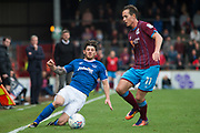 Portsmouth midfielder Matthew Kennedy (11) going in for a slide tackle against Scunthorpe United midfielder Josh Morris (11) during the EFL Sky Bet League 1 match between Scunthorpe United and Portsmouth at Glanford Park, Scunthorpe, England on 23 September 2017. Photo by Craig Zadoroznyj.