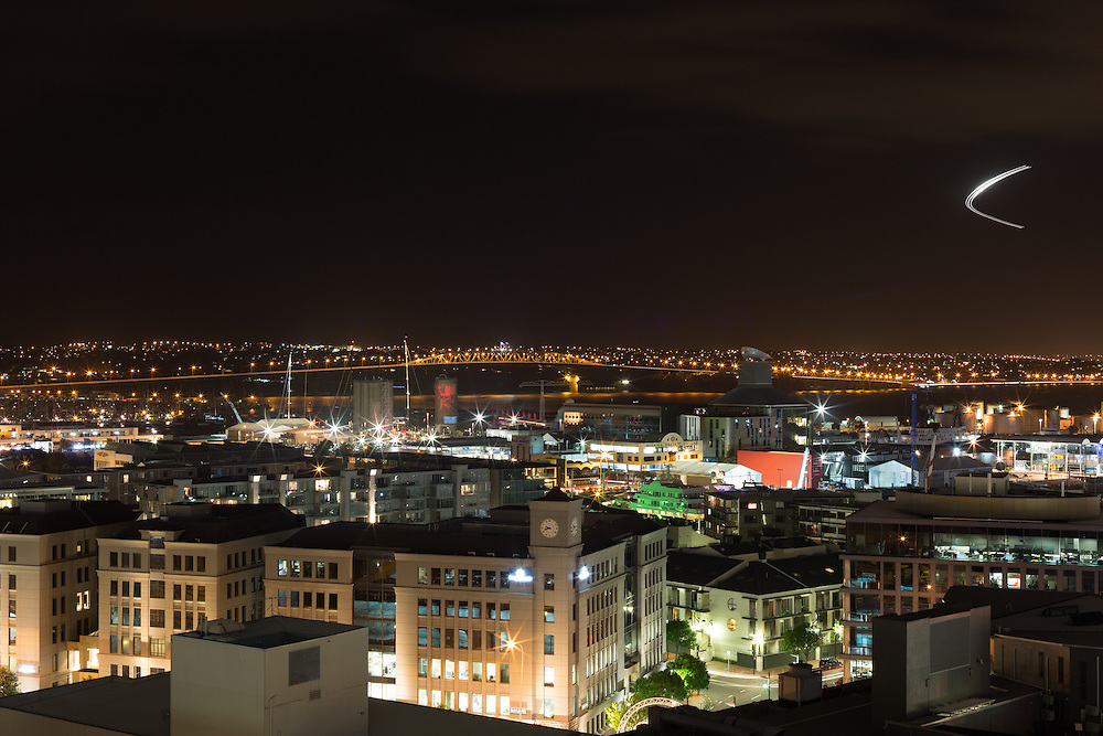Downtown Auckland waterfront district at night with Auckland Bridge in background, Valentines Day, 2013.
