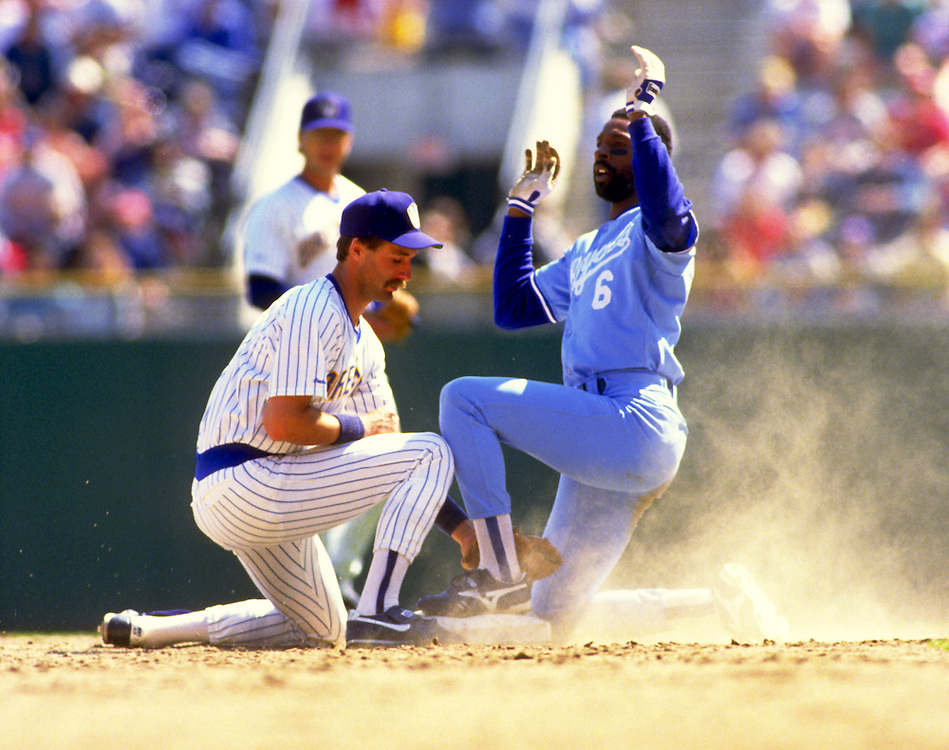 MILWAUKEE - 1988:  Willie Wilson of the Kansas City Royals steals second base under the tag of Dale Sveum of the Milwaukee Brewers during an MLB game at County Stadium in Milwaukee, Wisconsin.  WIlson played for the Royals from 1976-1990.  (Photo by Ron Vesely)
