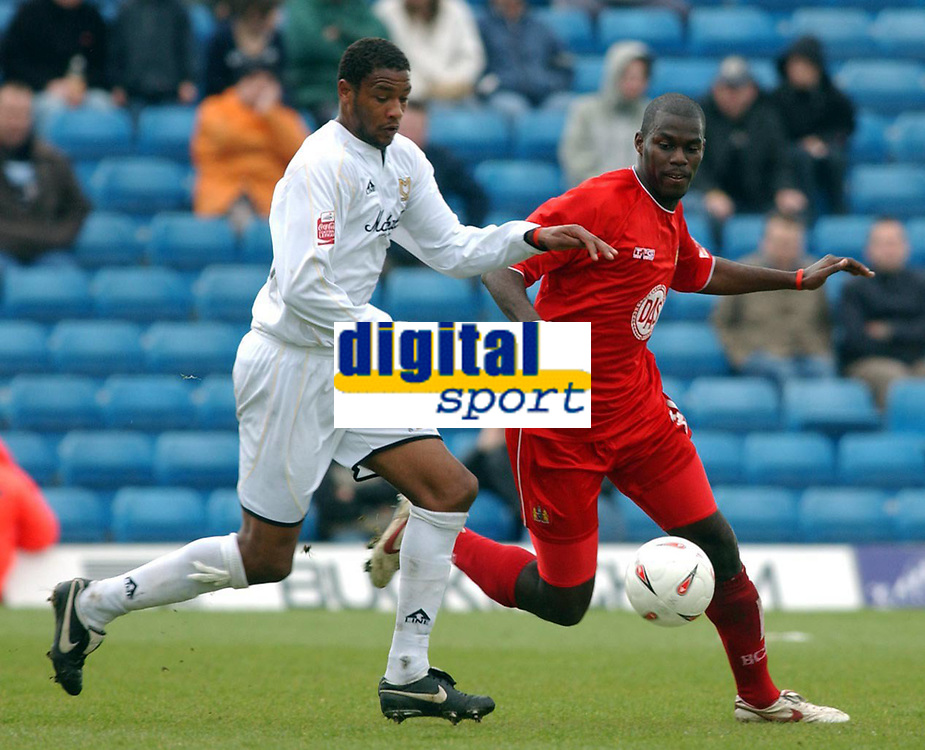 Photo: Daniel Hambury.<br /> Milton Keynes Dons V Bristol City.<br /> Coca Cola League One.<br /> 09/04/2005.<br /> MK Dons's Clive Platt and Bristol City's Clayton Fortune battle for the ball.