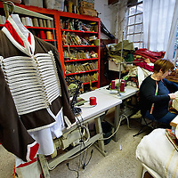 VENICE, ITALY - JANUARY 20:  Gabriella a tailor at the historic atelier Pietro Longi works on a Napoleonic costume on January 20, 2012 in Venice, Italy. This is one of the busiest periods of the year for the atelier as the next few weeks the streets and canals of Venice will be filled with people attending the carnival,  wearing highly-decorative and imaginative carnival costumes and masks.