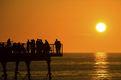 June 17, 2017 - Aberystwyth, UK..People drinking on the pier enjoying the warm evening as the sun begins to set over the sea  in Aberystwyth, on the Cardigan Bay coast of west Wales on has been the hottest weekend of the year so far, with more , even hotter weather forecast for tomorrow. (Credit Image: © Keith Morris/London News Pictures via ZUMA Wire)