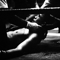 """Yangon, Myanmar May 2006<br /> Boxing fighters of the KLN boxing school. Most of them are part of the Karen minority ethnic group.<br /> On this picture: Boxer Htit Chone, 20 years old, finalist of the """"fly weight"""" category during the final match that he had lost.<br /> Photo: Ezequiel Scagnetti"""
