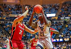 Dec 1, 2018; Morgantown, WV, USA; West Virginia Mountaineers forward Wesley Harris (21) drives down the lane during the second half against the Youngstown State Penguins at WVU Coliseum. Mandatory Credit: Ben Queen-USA TODAY Sports