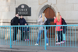 © Licensed to London News Pictures. 01/10/2016. LONDON, UK.  Tourists are still able to walk across Tower Bridge and take photographs. Tower Bridge closes to traffic today for three months for major renovations and repair. Pedestrians are still able to walk across the bridge. Photo credit: Vickie Flores/LNP
