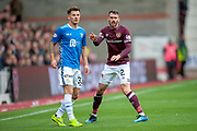 Matthew Kennedy (#33) of St Johnstone FC and Michael Smith (#2) of Heart of Midlothian during the Ladbrokes Scottish Premiership match between Heart of Midlothian and St Johnstone at Tynecastle Stadium, Gorgie, Scotland on 29 September 2018.