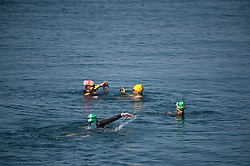 © Licensed to London News Pictures. 19/07/2016. Aberystwyth, Wales, UK. Teenagers  enjoying themselves jumping off the jetty into the cool clear water at the seaside in Aberystwyth, on  the hottest day of the year so far. The temperature is set to reach the mid 30's centigrade in parts of the south east of the UK today, before heavy thunderstorms sweep in on Wednesday .  Photo credit: Keith Morris/LNP