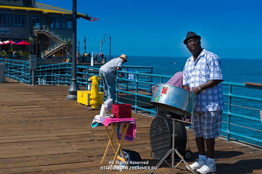 Street musician on Santa Monica pier boardwalk, Los Angeles, California