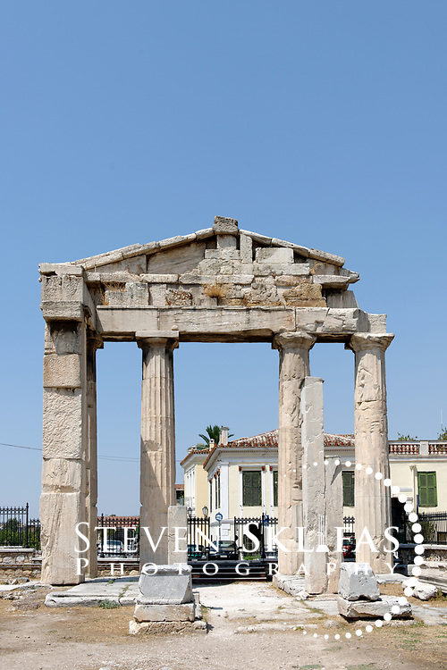 Athens. Greece. View of the Gate of Athena Archegetis, the monumental formal entrance to the ancient Roman Agora or Forum. Built in 11 BC, it consists of a Doric portico with four prostyles columns supporting a pediment of Pentelic marble. Dating from the 1st century BC, the Roman Agora is about 100 metres to the east of the Ancient Agora and is complex consisting of a large rectangular open courtyard surrounded by stoas, shops and storerooms.