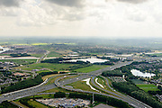 Nederland, Noord-Brabant, Gemeente Den Bosch, 26-06-2014;  knooppunt Empel, A2 A59. In de achtergrond Maximakanaal, directe verbinding tussen de Maas en de Zuid-Willemsvaart. <br />