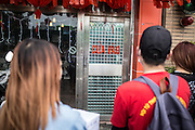 July 12, 2015: Kieu, accompanied by other members of Hội Từ Thiện Kết Nối Yêu Thương, prepare to enter a Karaoke bar in Taoyuan to seek donations for fellow Vietnamese migrant workers in need.