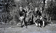 1920s four people posing on a little bench