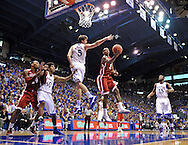 Jan 26, 2013; Lawrence, KS, USA; Oklahoma Sooners guard Buddy Heild (3) drives around Kansas Jayhawks center Jeff Withey (5) for a basket during the second half at Allen Fieldhouse. Kansas defeated Oklahoma 67-54.  Mandatory Credit: Peter G. Aiken-USA TODAY Sports
