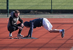 © Licensed to London News Pictures. 29/03/2020. London, UK. A man exercising with a personal trainer in Paddington Recreation Ground, London in the early morning sun, during a lockdown over the Coronavirus spread. Members of the public have been told they can only leave their homes to exercise briefly once a day, and to go to shops for essentials when absolutely necessary, in an attempt to fight the spread of COVID-19. Photo credit: Ben Cawthra/LNP