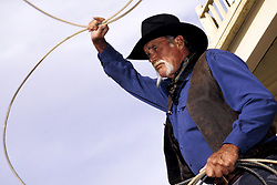North America, United States, New Mexico, Albuquerque. Cowboy wrangler with lasso rope (MR, PR)