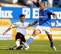 Mehdi Nafti of Birmingham avoids the tackle from